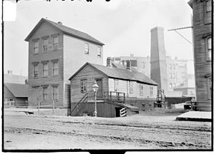 Little Italy, Chicago - A three story apartment house and a one story dwelling in Little Hell in September 1902.