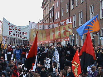 Ógra Shinn Féin - Members of Ógra Shinn Féin (along with SWP and WSM) protesting against the reintroduction of college fees, Dublin, February 2009. Note the use of the sunburst flag, a symbol of Fianna Éireann