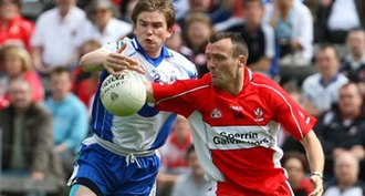 Paddy Bradley - Bradley (right) being tackled by Monaghan's Dessie Mone in the 2008 Championship