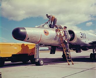"CFB North Bay - In 1952 No. 3 AW(F)OTU adopted the nickname ""Night Witches"", suggested by the wife of the unit's Engineering Officer, and the orange and black logo seen on the nose of this CF-100 interceptor trainer, denoting its all-weather day-or-night operations.  Department of National Defence image, courtesy 22 Wing Heritage Office Archives."