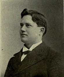 Portrait photo of Wylie Glidden Woodruff in 1898 in a suit looking to the left