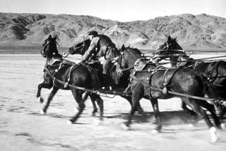 "Yakima Canutt - Yakima in John Ford's Stagecoach after doing the ""transfer"" part of his most famous stunt"