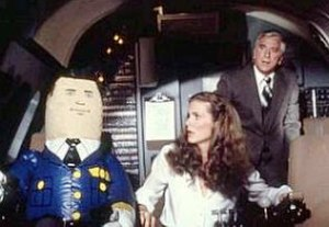"Airplane! - From left: the inflatable autopilot ""Otto"" with Julie Hagerty and Leslie Nielsen in the cockpit."