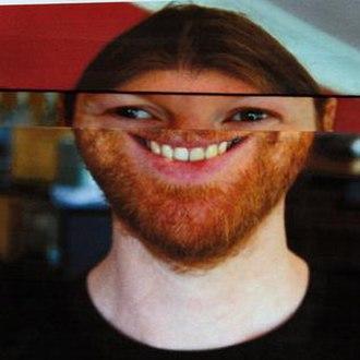 Syro - The album's main press photo, showcasing James' face folded