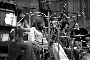 Henry Cow - Henry Cow with Robert Wyatt performing at the Piazza Navona, 1975. Left to right: Lindsay Cooper, Robert Wyatt, Dagmar Krause, Chris Cutler