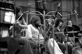 Henry Cow - Henry Cow with Robert Wyatt performing at the Piazza Navona, Rome, 1975 (l-r: Cooper, Wyatt, Krause, Cutler)