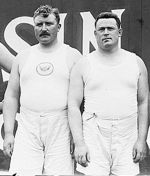 Irish American Athletic Club - Irish Whales: Pat McDonald and Matt McGrath of the Irish American Athletic Club, posing for a 1912 U.S. Olympic team photo.