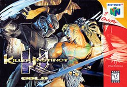 "Two stoic characters face each other, interlocking, as if about to engage, behind a gold logo that says ""Killer Instinct Gold"". A sidebar on the right shows the cube-like Nintendo 64 logo with a 3D peel-off tab that indicates that the game is exclusive to the console. A symbol indicates that the game is suitable for teens to play."
