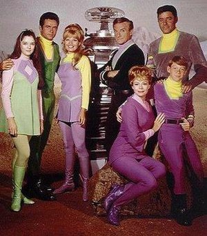 Mark Goddard - 1967 publicity photo showing cast members Angela Cartwright, Mark Goddard, Marta Kristen, Bob May (Robot), Jonathan Harris, June Lockhart, Guy Williams and Billy Mumy