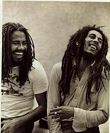 Jacob Miller with Bob Marley in what has become an iconic image of the latter.
