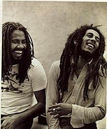 Miller (left) with Bob Marley