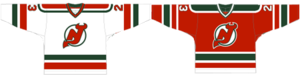 Two jerseys, the left primarily white, the right mostly red. Both feature red, white and green stripes at the bottom, the sleeves and the shoulders.