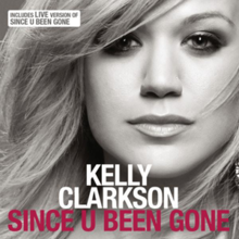 "A front face image of a blond woman. She is wearing a black tank top against a grey background and her hair is swept to the right. Below her chin, the word ""Kelly Clarkson"" is written in white capital letters. Below the word, ""Since U Been Gone"" is written in pink capital letters."