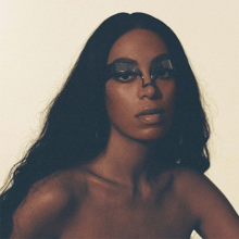 A photo of Knowles' face with makeup across her eyes