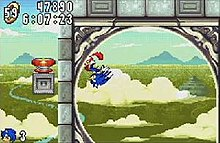Screenshot showing Sonic running around a loop in Angel Island zone, the game's fifth level. The HUD on the upper left-hand corner shows the timer, score, and amount of rings the player has.