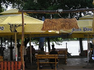 A river restaurant named Тропска врелина (in S...