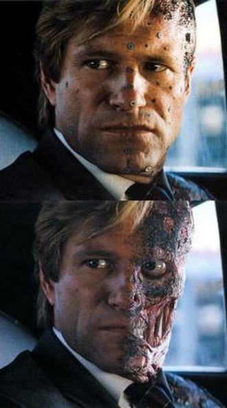 The Dark Knight (film) - Aaron Eckhart with make-up and motion capture markers on set. Below is the finished effect.