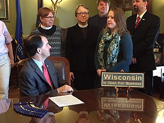 Jodi Emerson - Emerson with Governor Scott Walker at a bill signing in April 2016