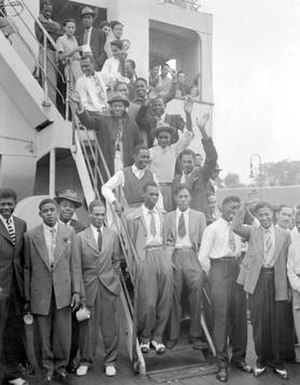 British Jamaican - Dozens of Jamaicans disembark the MV Empire Windrush at the Port of Tilbury in 1948