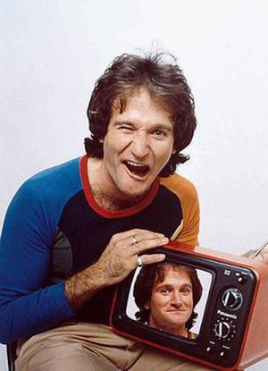 Robin Williams - Photo of Robin Williams, as printed on the March 12, 1979 cover of Time magazine, and installed in the National Portrait Gallery to commemorate him posthumously.