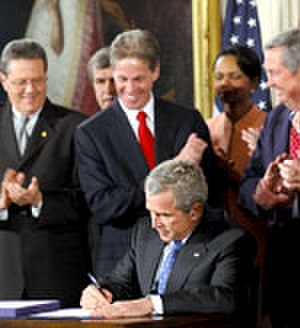 Norm Coleman - Picture of Coleman, President Bush, and others at DR-CAFTA signing