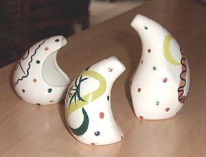 Clayburn Pottery - An anthropomorphic cruet set, painted with a version of Jessie Tait's 'Prima Vera' design