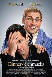 Steve Carell grinning maniacally stares from over Paul Rudds shoulder