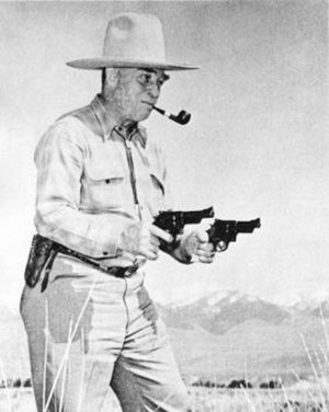 Elmer Keith - Elmer Keith shooting two revolvers at the same time.
