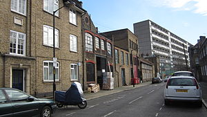 Walworth -  Old industrial buildings on Horsley Street, part of the Aylesbury Estate in the background.
