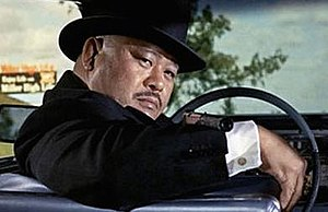 Oddjob - Harold Sakata as Oddjob in Goldfinger (1964).