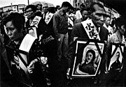 Minamata patients and family members hold photographs of their dead during a demonstration (W. E. Smith)