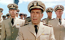 Bogart in Navy dress uniform with Fred MacMurray and other officers in a trailer for The Caine Mutiny