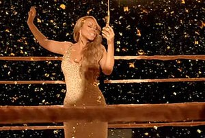 Triumphant (Get 'Em) - A still from the video's climax, in which Carey is shown singing ringside as confetti rains down. Critics noted this as the highlight of the video, and felt her passionate singing tied in well with the song's lyrical message.