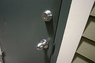 Dead bolt - Door with two locks, one in the doorknob and a separate deadbolt.