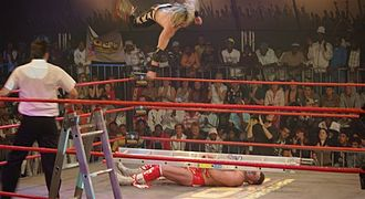 Angélico - Angélico executing a Superman Senton in a ladder match against Ananzi.