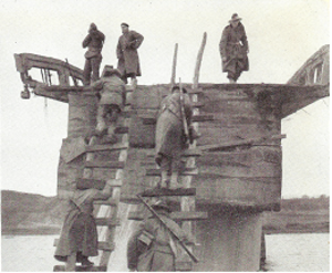 "Battle of Kujin - Australian soldiers scaling the ""Broken Bridge"" on the Taeryong River near Kujin, October 1950."