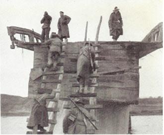 "Battle of Kujin - Australian soldiers scaling the ""Broken Bridge"" on the Taeryong River near Kujin, October 1950."