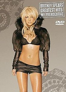 "Image of a blond woman dressed in a black ensemble in front of a gray background. ""Britney Spears Greatest Hits: My Prerogative"" is written in white capital letters inside a white box."