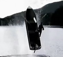 A boat exploding upward from a lake.