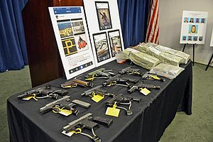 Columbia Point Dawgs - Weapons and cash seized from members of CPD.
