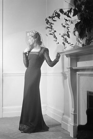 Peter Russell (fashion designer) - Peter Russell black dinner frock, produced during wartime and photographed by the Ministry of Information to promote the idea that utility could be incorporated into even high fashion. source: IWM