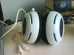 Headset (audio) - Front view of SteelSeries Siberia Neckband gaming headset. The microphone is on the left earcup. With standard 3.5 mm TRS connectors