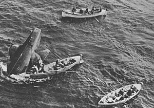 HMS Thetis (N25) - The stricken Thetis, surrounded by rescue boats