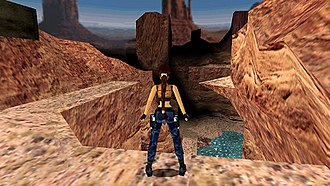Tomb Raider III - The player, controlling Lara Croft from a third-person perspective, progresses through the game's Nevada Desert level.
