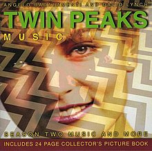 "A close-up of a smiling young woman with light skin and hair is overlaid on a picture of a short man wearing a red suit standing on black-and-white chevron floor. The words ""Twin Peaks"" are placed upon the woman's forehead in bold green writing, with the words ""Angelo Badalamenti and David Lynch"" and the word ""Music"" placed above and beneath ""Twin Peaks"" in smaller, thinner yellow writing. At the bottom of the cover, the phrases ""Season Two Music and More"" and ""Includes 24 Page Collector's Picture Book"" are printed in the same yellow writing."