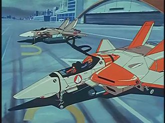 VF-1 Valkyrie - Hikaru and Roy sitting in a VF-1D dual-seater variant at South Ataria Island, 7 February 2009. Behind it is a single-seat variant, VF-1A. The VF-1 Valkyrie is referred to as a variable fighter in the series Macross, but this is changed to the term veritech fighter in the Robotech series.