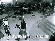 Eric Harris (left) and Dylan Klebold (right) caught on the high school's security cameras in the cafeteria, 11 minutes before their suicides