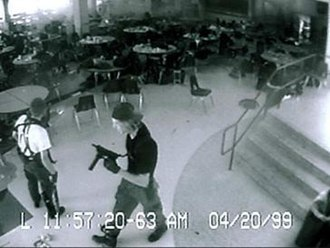 Columbine High School massacre - Eric Harris (left) and Dylan Klebold (right) caught on the high school's security cameras in the cafeteria, 11 minutes before their suicides