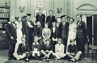 Housemaster (play) - 1936 cast. Seated, middle row, Kynaston Reeves as Ovington, Hilda Trevelyan as Barbara Fane, and Frederick Leister as Donkin