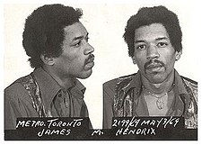 "A black and white ""mug shot"" of an arrested man."